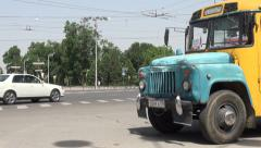 Old Soviet Union schoolbus in Dushanbe streets Stock Footage