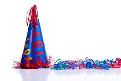 Birthday hat and streamers Stock Photos