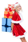 Christmas woman carrying many presents Stock Photos