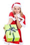 Christmas woman giving present Stock Photos