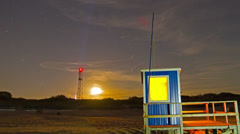 Lifeguard hut on the beach at night , time-lapse Stock Footage