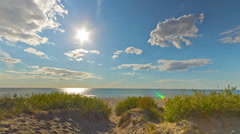 Shore, the dunes and the sun, time-lapse Stock Footage