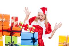 Surprised christmas woman looking at presents Stock Photos
