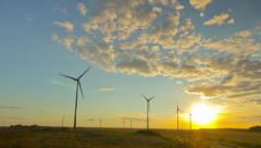 Windmills generators at sunset, timelapse - stock footage