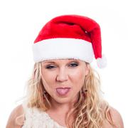 Christmas woman sticking out tongue Stock Photos