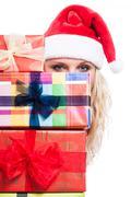Secret christmas woman behind presents Stock Photos
