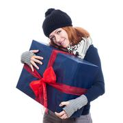 cute woman with big present - stock photo