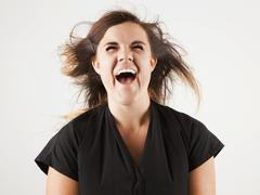 Studio portrait of young woman screaming Stock Photos