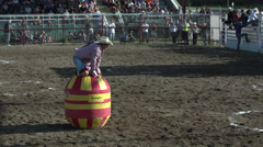 rodeo, bullfighter vs bull nice jump, fall and recovery - stock footage