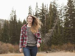 Portrait of young woman walking in non-urban scene Stock Photos