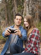 Young couple self photographing in non-urban scene Stock Photos