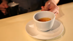 Barman makes picture on coffee with milk Stock Footage
