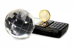 Glass globe is a mobile telephone and coin 1 euro Stock Photos