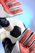 Soccer - football goal keeper stretching for ball Stock Photos
