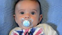 A baby and his dummy Stock Footage
