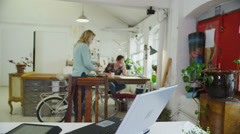 Young female student working with technology in a shared study space Stock Footage