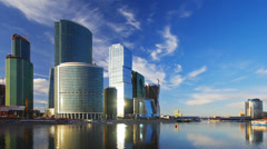 Modern office buildings by river, Moscow City, time-lapse. Stock Footage