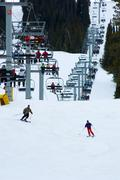 Busy snow ski resort with chairlift Stock Photos