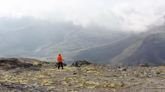 Girl stands in the mountains, the clouds run, accelerated video Stock Footage