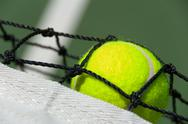 Stock Photo of tennis balls on court