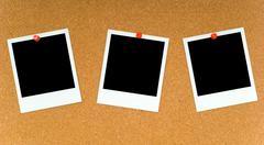Polaroids on corkboard Stock Photos
