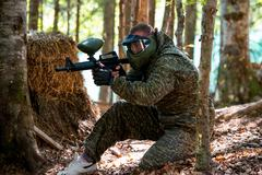 Sniper aiming gun Stock Photos
