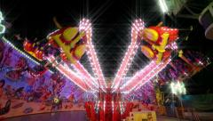 Funfair carousel jumping with dreamy look 11070 Stock Footage
