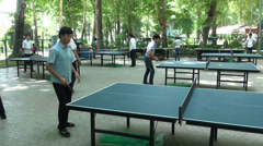 Tajik students play table tennis, sports, in a park Stock Footage