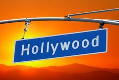 hollywood blvd sign with bright orange sunset sky - stock photo