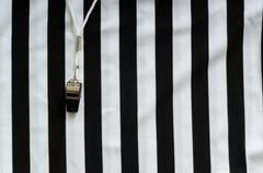 referee jersey and whistle - stock photo