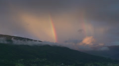 Time-lapse, rainbow fading over hills and into clouds! Stock Footage