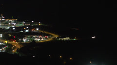 Time-lapse, night traffic, on the curved edge of town, aerial Stock Footage