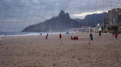 Kids practice and play football on Ipanema Beach Stock Footage