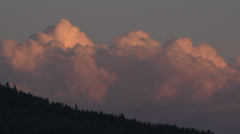 Stock Video Footage of time-lapse, sunset clouds along forest ridge decay after sunset