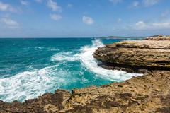 Devil's bridge antigua waves crashing on coastline Stock Photos