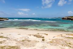 beautiful rustic caribbean sandy bay and sea - stock photo