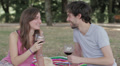 young lovers toasting with red wine at the camera HD Footage