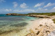 Stock Photo of beautiful rustic rocky tropical beach antigua