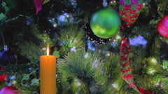 Glowing golden candle with Christmas decorations Stock Footage