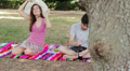 young couple takes a picnic to the park and drinking wine Footage