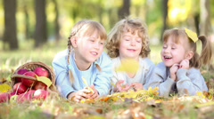 children in autumn park - stock footage