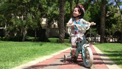 Kid learn to ride bycicles Stock Footage