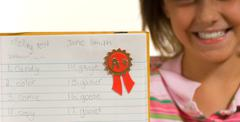 young girl with spelling test - stock photo