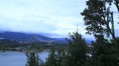 Lion's Gate Bridge with Moving Clouds and Traffic Time Lapse - stock footage