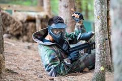 paintball player lying down - stock photo