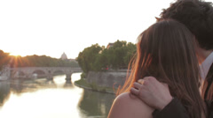 Stock Video Footage of two lovers admire the sunset, with the background of St Peter - sunshine