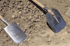 Shovel and spade at workplace Stock Photos