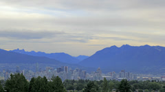 Urban Cityscape of Vancouver BC with Landscape Mountains Time Lapse 1920x1080 Stock Footage