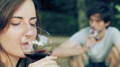 A man and a woman drink wine in sync Stock Footage