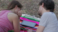 tablet - loving couple having fun watching pictures on a tablet at the park HD Footage